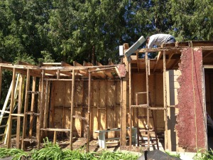 Demolishing a garage that was structurally unsafe due to rot.